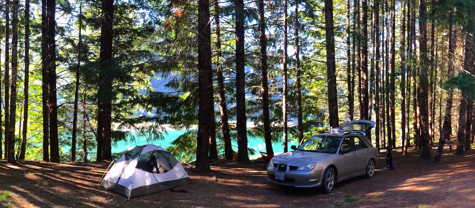 Tent camping with Subaru in trees near lake, Oregon
